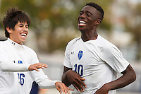Mishawaka Marian's Jordan Morris (10) and Francisco Tavarez (26) celebrate a goal by Morris against Providence during the IHSAA Class A Boys Soccer State Championship Game on Saturday, Oct. 29, 2016, at Carroll Stadium in Indianapolis. Marian won 4-0. Special to the Tribune/JAMES BROSHER