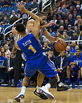 Nevada forward Caleb Martin (10) runs into South Dakota State guard Skyler Flatten (1) in the first half of an NCAA college basketball game in Reno, Nev., Saturday, Dec. 15, 2018. (AP Photo/Tom R. Smedes)