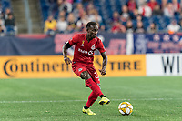 FOXBOROUGH, MA - AUGUST 31: Richie Laryea #22 of Toronto FC passes the ball during a game between Toronto FC and New England Revolution at Gillette Stadium on August 31, 2019 in Foxborough, Massachusetts.