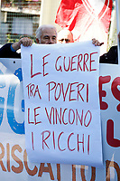 Banner wars between poors are winned by riches<br /> Rome April 6th 2019. Counterdemonstration of activists from the anti-fascist movements in the Torre Maura district of Rome, two days after Rome residents and neo-fascists burned bins and shouted racist slogans at Roma families being temporarily hosted in their neighbourhood. <br /> photo di Samantha Zucchi/Insidefoto