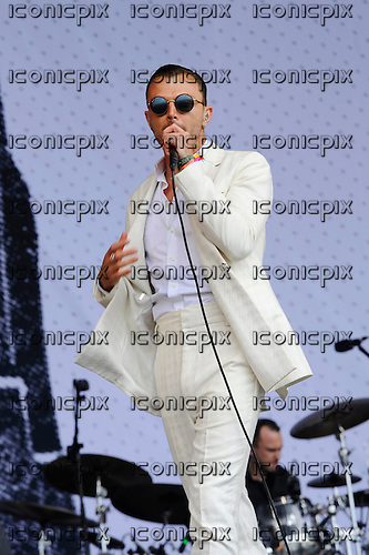 HURTS - vocalist Theo Hutchcraft - performing live on the Pyramid Stage on Day Two of the 2016 Glastonbury Festival at Worthy Farm Pilton Somerset UK - 25 Jun 2016.  Photo credit: Zaine Lewis/IconicPix