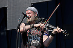 Sergey Ryabtsen of Gogol Bordello performs during the Hangout Music Fest in Gulf Shores, Alabama on May 19, 2012.