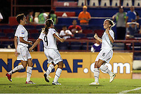 Amy Rodriguez of USA (R) celebrates a goal at the 2010 CONCACAF Women's World Cup Qualifying tournament held at Estadio Quintana Roo in Cancun, Mexico.