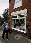 Port Vale 3 Doncaster Rovers 0, 22/08/2015. League One, Vale Park. A Doncaster fan passes The Vale Cafe near Vale Park. Photo by Paul Thompson.