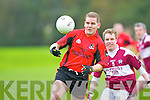 Killian Lynch Fossa controls the ball ahead of Alan Horan Scartaglen in their O'Donoghue cup clash in Fossa on Saturday..
