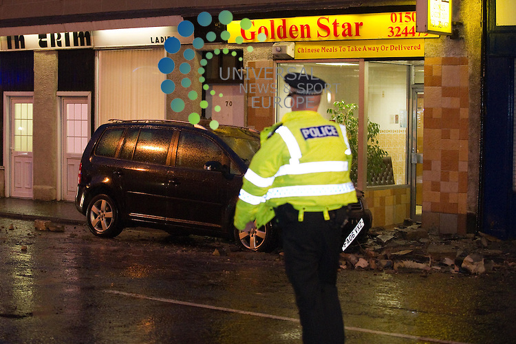 It wasn't quite the takeaway the driver had stopped for. But he got more than he bargained for at the Golden Star in High Street Johnstone after a chimney fell on to his. Luckily no-one was injured. 9 March 2011, Picture: Al Goold/Universal News and Sport (Europe) 2011.
