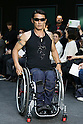 Wheelchair surfer Yoshihiro Kojima sits on a wheelchair and poses on the catwalk wearing clothes from the tenbo 2016 Spring-Summer Collection during the Mercedes-Benz Fashion Week Tokyo, in Roppongi on October 13, 2015, Tokyo, Japan. tenbo invited people with disabilities to join models and celebrities on the runway in a message of peace. The Mercedes-Benz Fashion Week Tokyo runs from October 12 to 17. (Photo by Rodrigo Reyes Marin/AFLO)