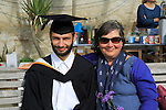 Portrait of mother and son graduation ceremony, University of Falmouth, Cornwall, England, UK - model released