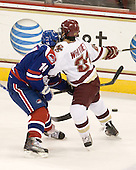 Joseph Pendenza (Lowell - 14), Steven Whitney (BC - 21) - The Boston College Eagles defeated the visiting University of Massachusetts-Lowell River Hawks 5-3 (EN) on Saturday, January 22, 2011, at Conte Forum in Chestnut Hill, Massachusetts.