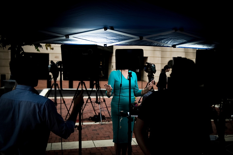 UNITED STATES – JULY 31: A correspondent for CBS is seen outside of the United States District Court in Alexandria, Virginia where President Donald Trump's former campaign manager Paul Manafort stands trial July 31, 2018.  (Photo By Sarah Silbiger/CQ Roll Call)