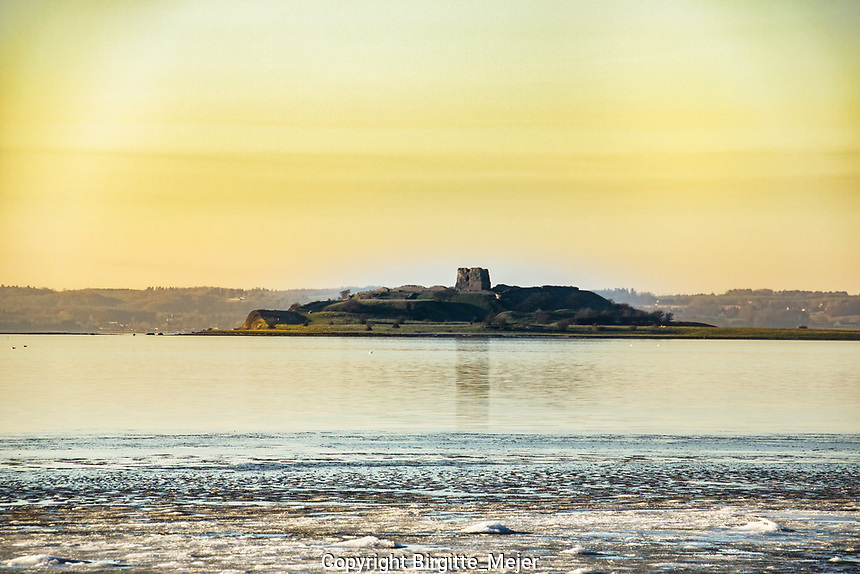 Tower of Kaloe ruin on a winter afternoon, photographed from the shore
