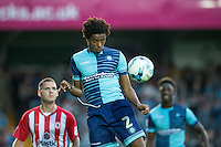 Sido Jombati of Wycombe Wanderers clears the ball during the Sky Bet League 2 match between Wycombe Wanderers and Accrington Stanley at Adams Park, High Wycombe, England on 16 August 2016. Photo by Andy Rowland.