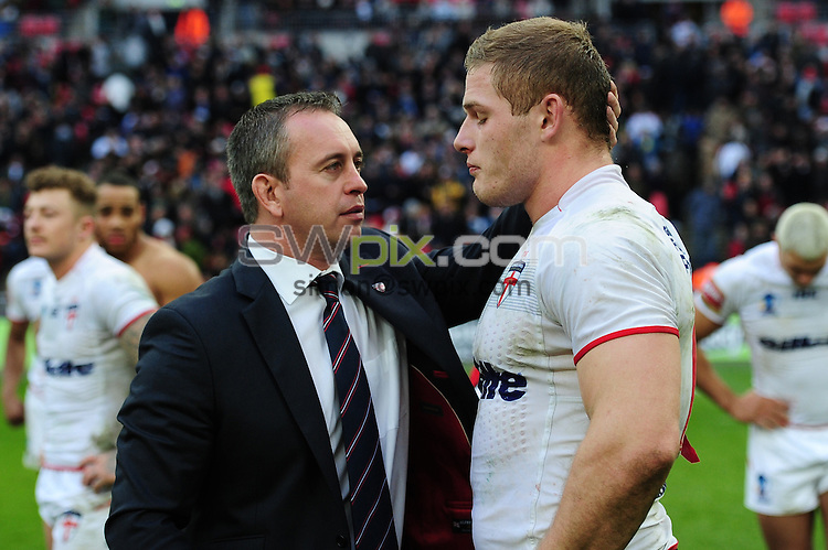 Picture by Alex Broadway/SWpix.com - 23/11/2013 - Rugby League - Rugby League World Cup Semi Final - New Zealand v England - Wembley Stadium, London, England - George Burgess of England is consoled by Steve Mcnamara after the final whistle.