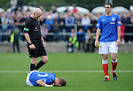 David Templeton pulls up and collapses on the plastic pitch injured