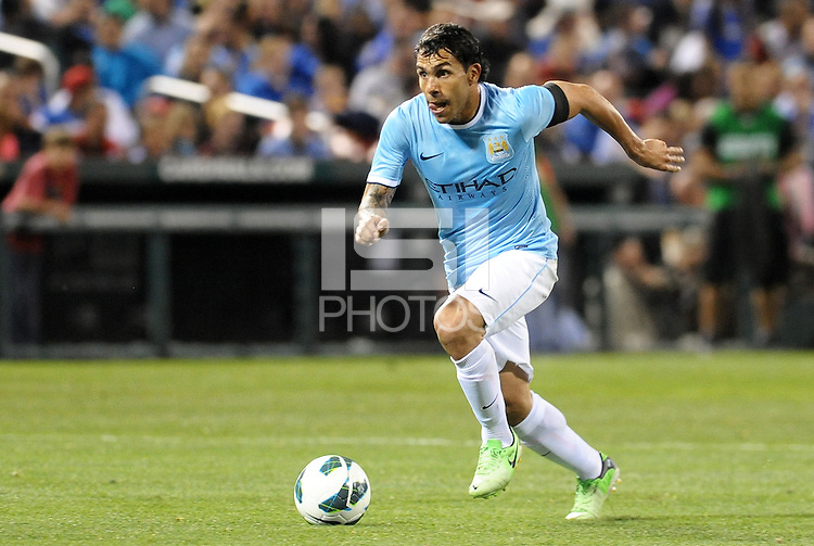 Carlos Tevez (32) Manchester City drives at the Chelsea goal..Manchester City defeated Chelsea 4-3 in an international friendly at Busch Stadium, St Louis, Missouri.
