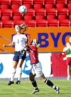 Heather Mitts (2) heads the ball over Norway's Isabell Herlovsen. USA 4,  Norway 0, Fredrikstad Stadium, July 2, 2008.