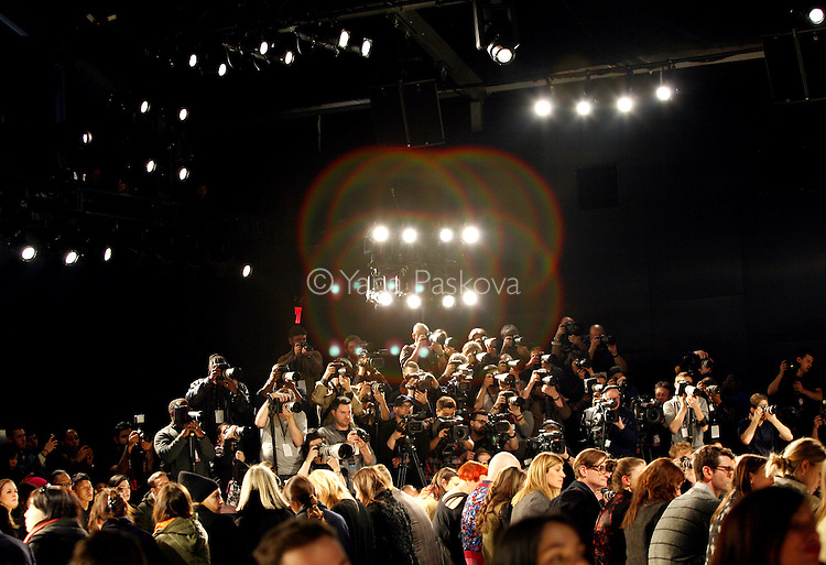 Photographers in the media pit shoot the Creatures of the Wind show at the Lincoln Center in Manhattan, New York, on February 6, 2014, the first day of that season's Mercedes-Benz Fashion Week.