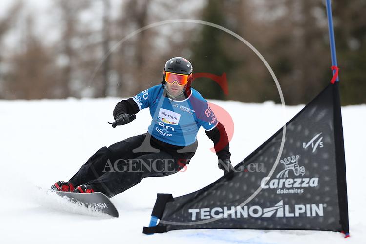 Parallel Slalom event of the FIS Snowboard World Cup on 19/12/2019 in Carezza, Italy.<br />  Aleksandar Kacarski (MKD)