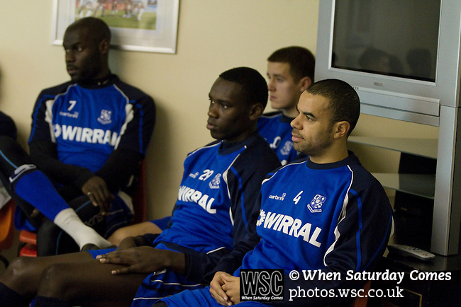 Rochdale v Tranmere Rovers preparations, 31/12/2010. Prenton Park, League One. Tranmere Rovers players (l to r) Enoch Showunmi, Germaine Grandison and Marlon Broomes watching and listening to coach David Low's briefing the first team squad at the club's Prenton Park ground, as the club prepare for the following day's Npower League 1 fixture away to Rochdale. It was the first league fixture between the teams since March 1989. Rochdale won this latest encounter by three goals to two watched by a crowd of 5,500. Photo by Colin McPherson.