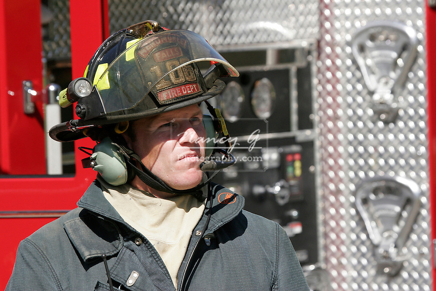 Fire Fighter on a call waiting for communication from the crew