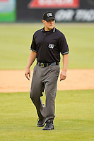 Umpire Ryan Bealo handles the calls on the bases during the South Atlantic League game between the Greensboro Grasshoppers and the Kannapolis Intimidators at CMC-Northeast Stadium on June 12, 2012 in Kannapolis, North Carolina.  The Intimidators defeated the Grasshoppers 2-1.  (Brian Westerholt/Four Seam Images)