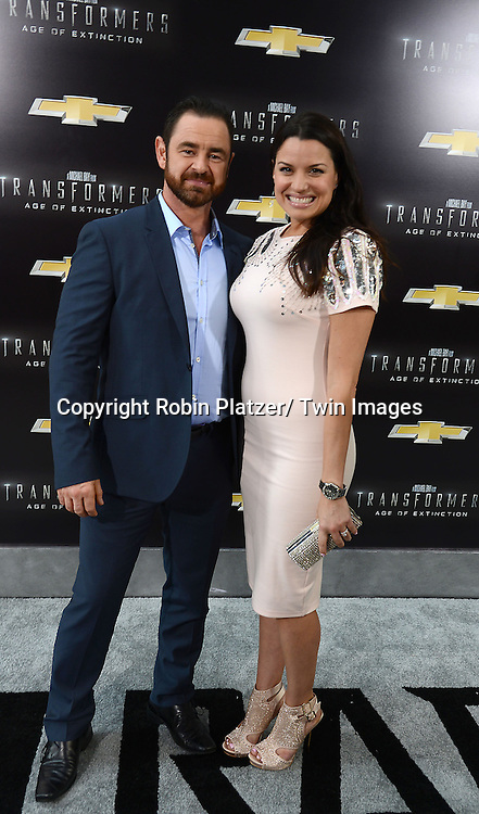 "Glenn Keough and wife Caroline Morahan attends the US Premiere of ""Transformers: Age of Extinction"" on June 25, 2014 at The Ziegfeld Theatre in New York City, New York, USA."