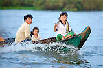 Family In Dugout Canoe