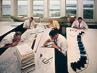 Engineers work on ship plans, Arendal Shipyard, Sweden. 1965. Photo by John G. Zimmerman.