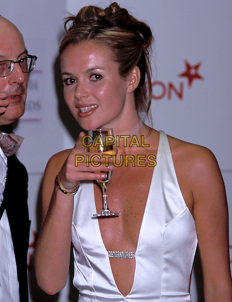 AMANDA HOLDEN.British TV Soap Awards 2001.Ref: 10874.drinking champagne, talking, white, halterneck, open front, half length.sales@capitalpictures.com.www.capitalpictures.com.©Capital Pictures