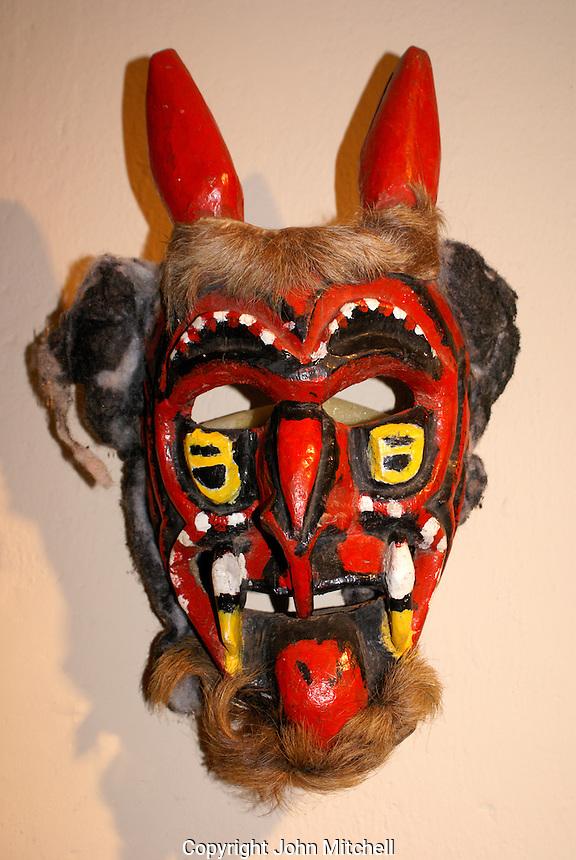 Ceremonial devil mask in the Museo de Arte Popular or Museum of Popular Art in San Salvador, El Salvador