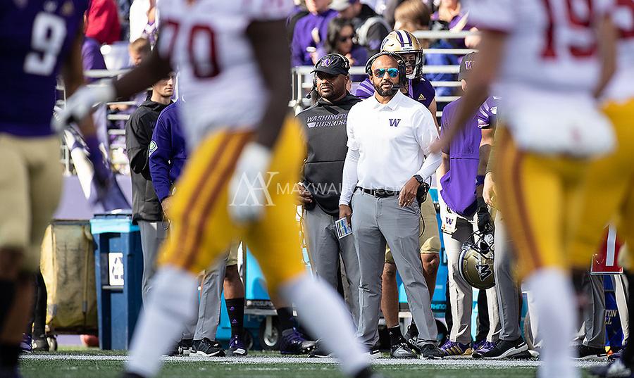 Defensive coordinator Jimmy Lake looks on.