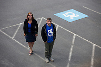 Dr. Brian Glenney (right), Professor of Philosophy at Gordon College, in Wenham, Massachusetts, helped develop the Accessible Icon as part of the Accessible Icon Project.  Cyndi McMahon, Director of Marketing Communications at Gordon College, is the volunteer publicist for the Accessible Icon Project and has helped spread usage of the symbol. The icon is a redesign of the International Symbol of Access (also known as the handicap symbol) that shows an active and engaged person with arms in motion.  Glenney's research focuses on the philosophy of perception and he maintains active interest in graffiti and street art.  The Accessible Icon has been adopted by cities and institutions around the world, including Gordon College, Nissan, New York City, Malden, MA, and others.