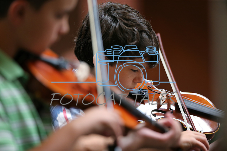 Nathan Powers, 11, performs at the Carson City Symphony's Youth Strings Summer Program concert in Carson City, Nev., on Thursday, July 27, 2017. <br /> Photo by Cathleen Allison