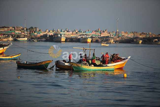 Palestinian fishermen ride their fishing boat at the beach of Gaza City, on April 4, 2016. Israel on Sunday extended the distance it permits Gaza fishermen to head out to sea along certain parts of the coastline of the enclave, which is run by the Islamist group Hamas. The fishing zone was expanded from six nautical miles (11 km) to nine (16 km) along Gaza's central and southern shores, a step that Israeli authorities said should result in a bigger catch in deeper waters, where fish are more abundant. Photo by Ashraf Amra