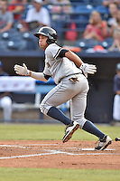 Charleston RiverDogs second baseman Vince Conde (4) swings at a pitch during a game against the Asheville Tourists on June 30, 2015 in Asheville, North Carolina. The RiverDogs defeated the Tourists 10-4. (Tony Farlow/Four Seam Images)