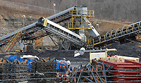 Workers remove equipment in the yard Monday, Jan. 9, 2006,  at the Sago mine near Buckhannon, WV, where 12  miners were killed in an explosion. (Gary Gardiner/EyePush Newsphotos)..<br />
