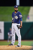 San Antonio Missions pitcher Luis De La Cruz (27) looks in for the sign during a game against the NW Arkansas Naturals on May 30, 2015 at Arvest Ballpark in Springdale, Arkansas.  San Antonio defeated NW Arkansas 5-2.  (Mike Janes/Four Seam Images)