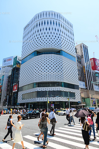 Pedestrians walk past the Ginza Place under construction in Ginza shopping area on June 17, 2016, Tokyo, Japan. Set in an upscale shopping area, the 11-story Ginza Place shopping complex will feature stores and restaurants along with the Nissan showroom. It will also temporarily house the Sony showroom after Sony Plaza closes in March 2017. (Photo by Rodrigo Reyes Marin/AFLO)