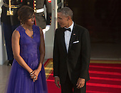 United States President Barack Obama and first lady Michelle Obama await the arrival of Prime Minister Shinzo Abe of Japan and his wife Akie Abe to The White House in Washington DC for a State Dinner, April 28, 2015. <br /> Credit: Chris Kleponis / CNP