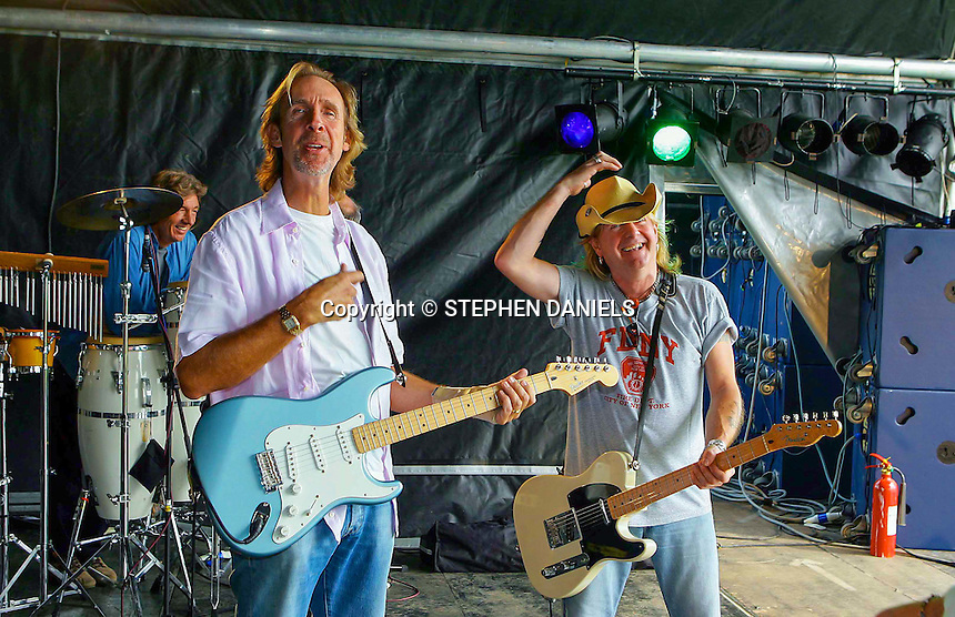 PHOTO © Stephen Daniels  2006<br /> The Jones Gang rehearsal for REASON 2 ROCK FESTIVAL, Hurtwood Park Polo Club, Ewhurst Green, Surrey. <br /> L/R Nick Cook, Mike Rutherford and Dave BUCKET Colwell