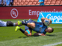 Argentina's Franco Sabato scores during the men's pool match against Fiji. Day two of the 2020 HSBC World Sevens Series Hamilton at FMG Stadium in Hamilton, New Zealand on Sunday, 26 January 2020. Photo: Dave Lintott / lintottphoto.co.nz