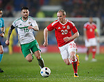 Oliver Norwood of Northern Ireland chases Jonathan Williams of Wales during the international friendly match at the Cardiff City Stadium. Photo credit should read: Philip Oldham/Sportimage