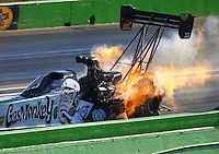 Oct 17, 2015; Ennis, TX, USA; NHRA top fuel driver Kebin Kinsley explodes an engine on fire during qualifying for the Fall Nationals at the Texas Motorplex. Mandatory Credit: Mark J. Rebilas-USA TODAY Sports