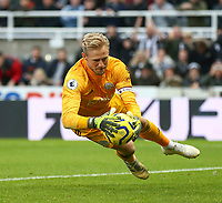 1st January 2020; St James Park, Newcastle, Tyne and Wear, England; English Premier League Football, Newcastle United versus Leicester City; Kasper Schmeichel of Leicester City dives to save a header from Joelinton of Newcastle United  - Strictly Editorial Use Only. No use with unauthorized audio, video, data, fixture lists, club/league logos or 'live' services. Online in-match use limited to 120 images, no video emulation. No use in betting, games or single club/league/player publications