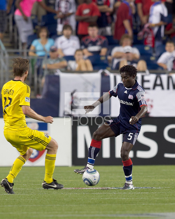 New England Revolution defender Emmanuel Osei (5) controls the ball as Columbus Crew midfielder Eddie Gaven (12) closes. The New England Revolution tied Columbus Crew, 2-2, at Gillette Stadium on September 25, 2010.