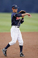 Richie Pedroza #6 of the Cal. St. Fullerton Titans makes a throw during game against the Cal. St. Long Beach 49'ers at Goodwin Field in Fullerton,California on May 14, 2011. Photo by Larry Goren/Four Seam Images