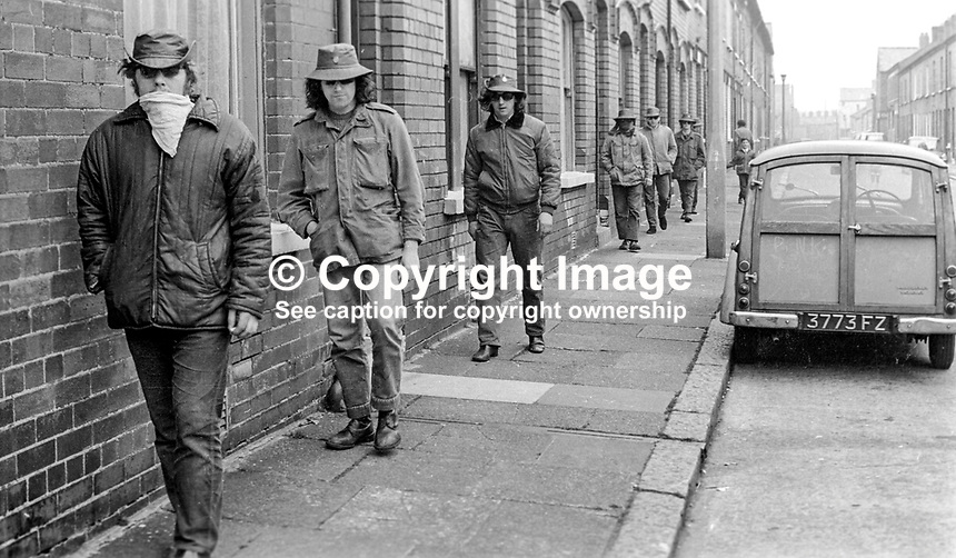 Masked members of the loyalist para-military Ulster Defence Association on foot patrol in the predominently Protestant Woodvale district of Belfast, N Ireland, UK, on 14th May 1972. 197205140563f<br />