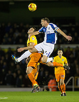 Lee Mansell of Bristol Rovers and Matthew Bloomfield of Wycombe Wanderers go for the ball during the Sky Bet League 2 rearranged match between Bristol Rovers and Wycombe Wanderers at the Memorial Stadium, Bristol, England on 1 December 2015. Photo by Andy Rowland.