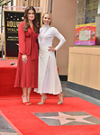 a_ Idina Menzel, Kristen Bell -Double Stars 001 ,  Kristen Bell And Idina Menzel  Honored With Stars On The Hollywood Walk Of Fame on November 19, 2019 in Hollywood, California