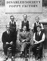 BNPS.co.uk (01202 558833)<br /> Pic: PoppyFactory/BNPS<br /> <br /> PICTURED: Major George Howson (centre, front) with factory workers<br /> <br /> The bravery medals awarded to a heroic First World War army officer who went on to found the pioneering Poppy Factory have emerged for sale.<br /> <br /> Major George Howson received the prestigious Military Cross for his gallantry at the Battle of Passchendaele in July 1917, carrying out his duties despite receiving a nasty shrapnel wound.<br /> <br /> Four years after the war he set up the factory that started making artificial poppies to offer jobs to wounded soldiers returning from the battlefield.<br /> <br /> To this day the Poppy Factory in Richmond, Surrey, produces 36 million poppies each year.
